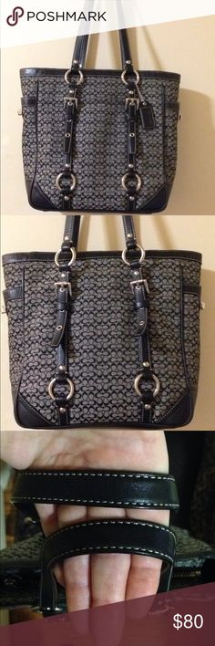 Coach bag Classy Coach tote! It's black and grey with silver detail and turn locks on each side of the bag. This is in excellent condition! Coach Bags Totes