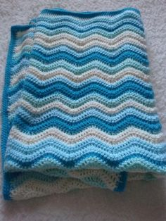 wave baby blanket | Ripple Waves Baby Blanket Crochet Pattern | Red Heart -- Looks so much cuter than the one on the Red Heart website!