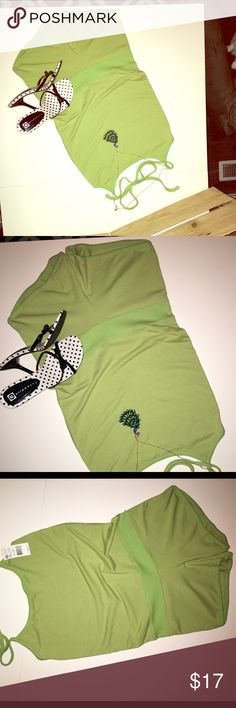 Adorable! Green shorts jumpsuit This is adorable! Never been worn, still has the tags on it, sleeveless, super sexy, short shorts light green jumpsuit. This is a steal! I accept reasonable offers and offer a bundle discount. Let me know how I can help you get this sexy number into your personal closet. 😊✨ Split Shorts
