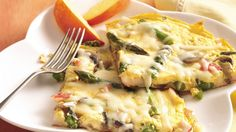Dress up ordinary eggs with asparagus, mushrooms and imitation crabmeat. Take it to the table in 20 minutes!