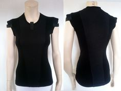 Black cyberpunk vest industrial shirt. Edgy and unique design inspired by Sci-Fi. SIZE 36 EU: Chest: 84cm / 33 1/8 Waist 64 cm / 25 1/4 Hips: 90 cm / 35 3/8  Prototype SALE!  KEY FEATURES  – 3D mesh fabric on shoulders – for an edgy look; – Qualitative dense jersey fabric - nice and soft. – Labels are sewn on separately so you can remove it without damaging the garment.