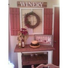 """Homemade shutters from a pallet $0.50, an old window $10, a grapevine wreath $4, 4 leftover 1X2's from another project, stained and glued together, 5"""" stencils already onhand; total project $14.50!"""