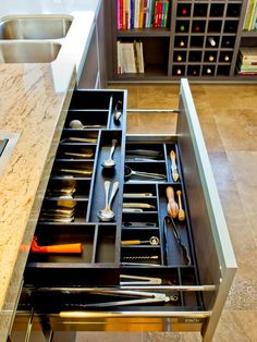 How wonderful! A place to store both your everyday silverware & beneath it your kitchen utensils!