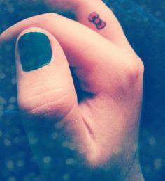 Hello Kitty bow finger tat! #Hello #Kitty #tattoo #Hello Kitty #bow #tattoo #finger #tattoo #small #tattoos