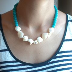 """Length: 16 1/2"""" Extender: 2"""" Lobster clasp closure Turquoise / seashell / silver plated"""