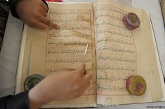 An Indian-paper conservator restores an antique copy of the Koran at Chowmahalla Palace in Hyderabad.