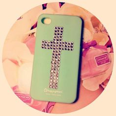 mint color, sparkle, cross. what more could I want in a phone case?