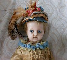 Beautiful German Wax Doll with Striking Blue Glass Eyes