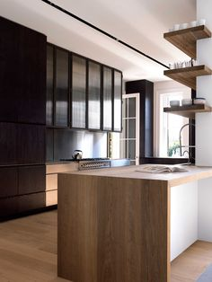 Shelving Design Idea - Shelves That Wrap Around Corners // These shelves wrapped around the partial wall in this kitchen are a unique take on the open shelving trend.