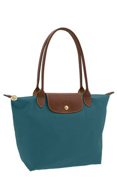 Longchamp Le Pliage-LOVE THESE BAGS!  Perfect everyday, holds laptop, change of clothes for the gym, awesome!