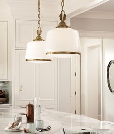 These brass schoolhouse pendants will add that art deco feel to my kitchen