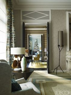 A view of the enfilade from the master bedroom to the living room; the floor lamp is by Deniot.