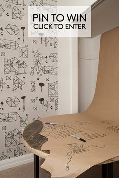 Pin to Win $1000 Shopping Spree.  Heather Lipner's use of a fun and quirky wallpaper keeps this room interesting with an balance of geometric shapes and structured furniture.  This is a great work space!