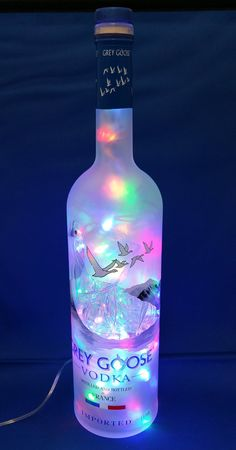 GREY GOOSE Liquor bottle lamp with multicolor LED by CachyCreation on Etsy crafts house This item is unavailable Liquor Bottle Lights, Liquor Bottle Crafts, Alcohol Bottles, Wine Bottle Art, Diy Bottle, Liquor Bottles, Glass Bottles, Alcohol Bottle Decorations, Liquor Drinks