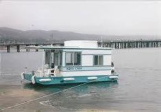 """DIY """"Aqua Casa"""" houseboat: comes in a 16 foot model (pictured) or a 20 foot… Trailerable Houseboats, Small Houseboats, Pontoon Houseboat, Houseboat Living, Pontoon Boats, Houseboat Ideas, Shanty Boat, Tiny House Blog, Boats"""