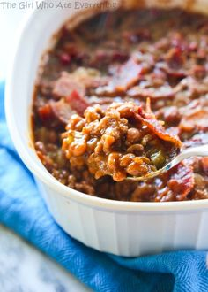 The Best Baked Beans Recipe - hearty and thick, simmering in a savory sauce.