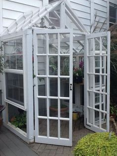 Greenhouse made from recycled windows and doors with reclaimed wood. - Greenhouse made from recycled windows and doors with reclaimed wood. Diy Greenhouse Plans, Greenhouse Supplies, Backyard Greenhouse, Greenhouse Wedding, Cheap Greenhouse, Portable Greenhouse, Old Window Greenhouse, Homemade Greenhouse, Diy Small Greenhouse