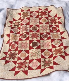 Auction quilt in red white and blues.