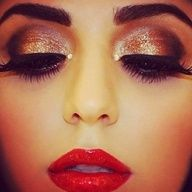 new years makeup! bright, bold red lip, dark gold shimmer, dark brown glitter crease, thick liner, false lash with thick mascara, filled in dark brow, bare minerals for face, rosy cheek