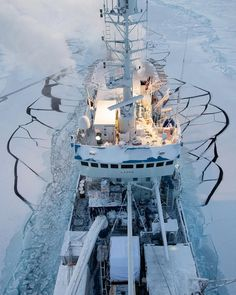 """""""Photo by @nickcobbing Looking down over the Lance ship as the research vessel moves through the sea ice in the Arctic Ocean. The surrounding cracks mean…"""""""