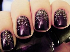 Plum nails with tiny gorgeous gold glitter near cuticles.