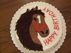 """This was for a little boy who loved horses. This was a pattern used by another contributor to this site, thank you. I used chocolate b/c frosting for the mane. This was just a single layer 9"""" round white cake. I transferred the design onto the cake with piping gel and filled in with b/c."""
