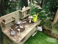 """20 ideas for """"mud kitchens."""" Our kind of outdoor kitchen for sure."""