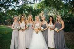 Mismatched bridesmaids--pick a colour and let your ladies choose from different shades & looks. Keeping the dress from the same designer and of similar fabrics (these are Jenny Yoo) will give a cohesive feeling to your lovely group.