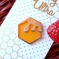 """Honeycomb Translucent Enamel Pin A simple honeycomb enamel pin with translucent enamel for the """"honey""""! ♡ This pin measures 1 inch wide and features gold colored metal with white screen printed details Broches Disney, Jacket Pins, Cool Pins, Pin And Patches, Metal Pins, Disney Pins, Pin Badges, Lapel Pins, Pin Collection"""