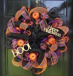 Poly Deco Mesh--Black Spooky Wreath. $75.00, via Etsy.