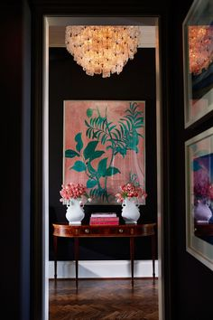 Dark walls + stunning light fixture. Entryway designed by Martensen Jones Interiors | D Home