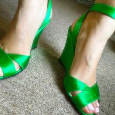 Christian Louboutin Wedges Authentic green satin Louboutin wedges. Perfect for a bride, wedding parties, floral dresses, garden parties. Runs small, fits size 6-7 best. Very comfortable. In great condition. Comes in box and dust bag. Full price purchase will receive printed tank top seen in picture 4. No low balls or trade and I only sell in Poshmark. My mom bought but too small for her. Her loss, your gain. Christian Louboutin Shoes