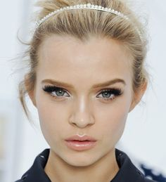 Sparkly headband, messy up-do, full eyelashes, hint of a smokey eye with silver eyeshadow, and nude lips. My favorite look!