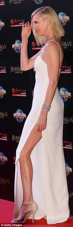 Finishing touches: Charlize also dazzled on the night, adding more height to her modelesqu...