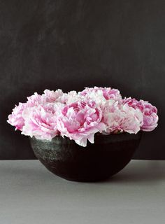 Pink flowers in a bowls against charcoal gray...it does not get any prettier than that!