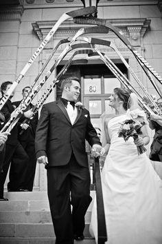 Love the hockey sticks! Photo by Kim. #WeddingPhotographerMinnesota #Hockeyfan #WeddingIdea