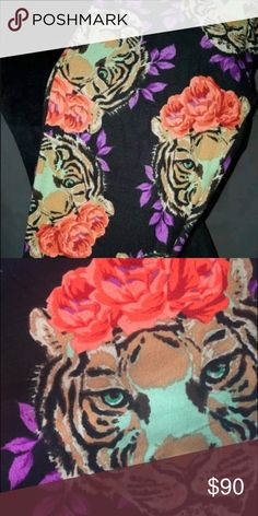 Lularoe OS tiger floral leggings *rare unicorn* 🦄 Brand new with tags. These are even more beautiful in person! Black background with coral flowers, some purple and a beautiful light green in the face. Very rare unicorn!! 🦄 LuLaRoe Pants Leggings