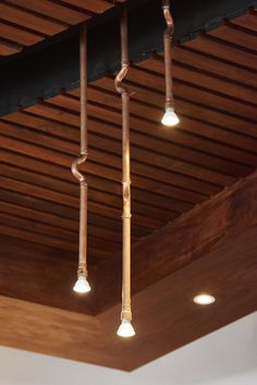 Simple copper pipe spot lights are suspended from a slatted Kiaat ceiling. Another way to put copper to better use.