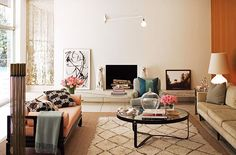 Beni Ourain Rug frames a modern warm living space.