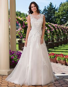 A traditional ball gown featuring a Sabrina neckline with corded lace on organza, basque waistline, plunging lace up back, and chapel length train. https://www.sinceritybridal.com/wedding_dress/3924
