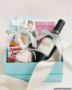 """Good Idea for a prize - DVD of """"Breakfast at Tiffany's,"""" a bottle of our favorite wine, and a box of Cracker Jacks (a nod to the movie)...."""