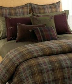 Love this cozy forest green tartan comforter, minus all the ugly pillows though.