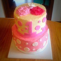 Pink polka dot first birthday cake