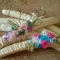 Hand Decorated Clothes hangers Set of 5 satin padded Clothes Hangers. 3 are plain, 2 are hand Decorated with satin flowers and ribbons. Use to uniquely display a beautiful lingerie piece for the bride to be or to hand a special little girls dress or to hang your favorite blouse. Only 1 set left. Make offer Other