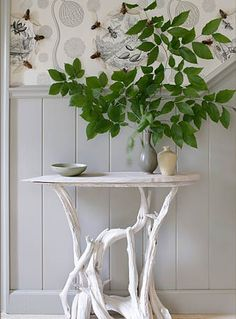 table made from branches and a piece of board and then painted...so unique.