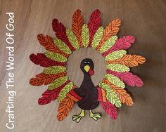 This cute turkey wreath will look great hanging from your door. The wreath can also be decorated using craft feathers or fall leaves. Instructions Cut out the inner circle of a paper plate. You wil...