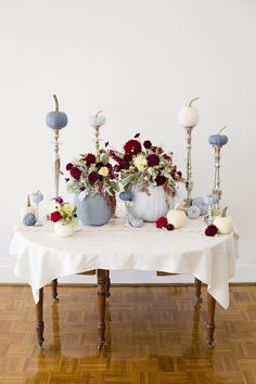 Dusty blue and cranberry fall tablescape with painted pumpkins! See how to recreate this look on the blog!   https://www.thebridelink.com/blog/2014/10/02/diy-fall-tablescape-with-painted-pumpkins/