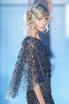 Elie Saab's array of beaded gowns from his haute couture collection shown in Paris yesterday set the scene for an ultra-feminine hair and makeup look. Along similar lines of what we saw at the Spring '11 haute couture sho
