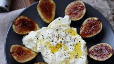 "Halved fresh figs are sprinkled with sugar and caramelized, then served with creamy Burrata cheese--or, as Chef John says, ""grab a pint of vanilla ice cream"" if you prefer."