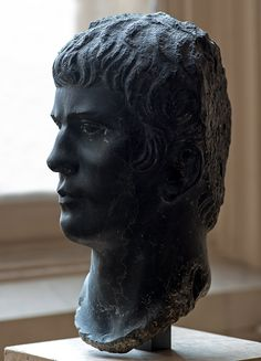 Agrippa Postumus, son of M. Vipsanius Agrippa and Julia the Elder, grandson and adopted son of Augustus - profile, head of Roman sculpture (basanite), 1st century AD, (Musée du Louvre, Paris).